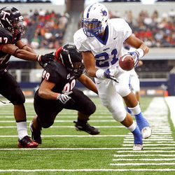 Bingham running back Harvey Langi heads toward the end zone for a score as the Miners play Euless (Texas) Trinity Monday in the Kirk Herbstreit Varsity Football Series at Dallas Cowboys Stadium in Arlington, Texas. Trinity won 42-21.