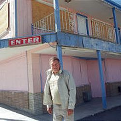 Businessman Bob Perchetti stands in front of the L\&L Motel in Tonopah, Nev., in April 2002. The secret wedding of billionaire Howard Hughes and actress Jean Peters took place at the motel in 1957.