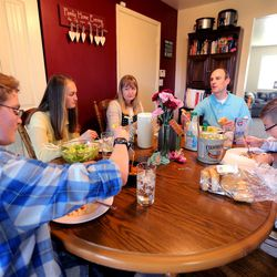 Dave and Becky Evans enjoy dinner at home Monday, May 11, 2015, together with three of their children Lincoln, Julia and Isaac in Murray.