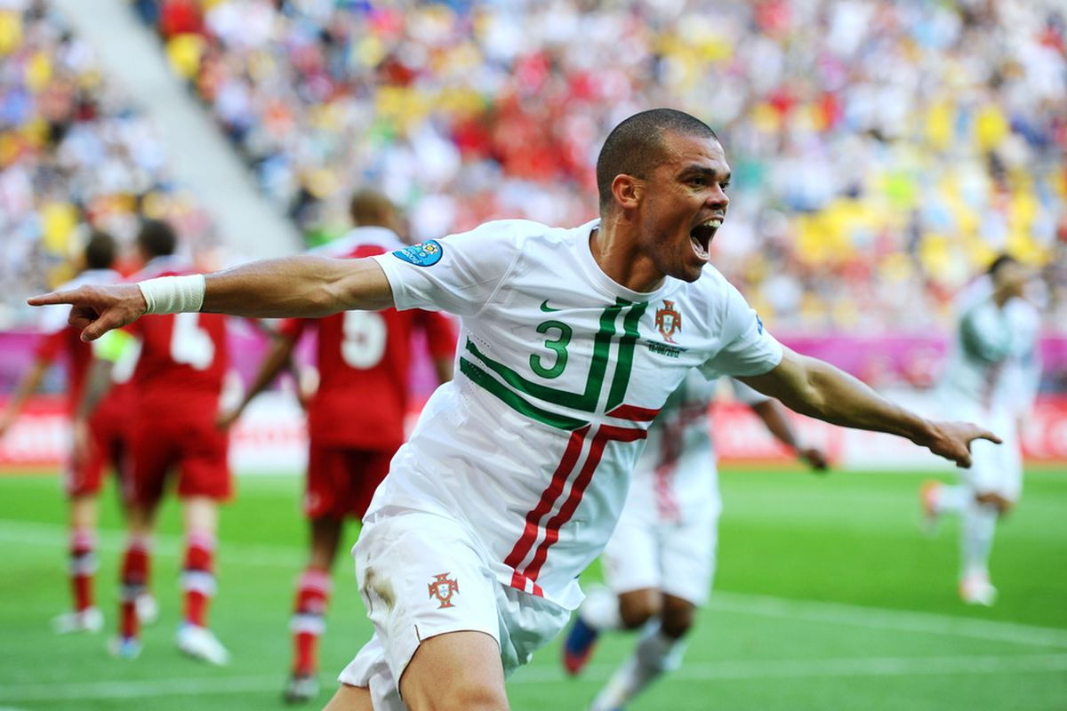 L'VIV, UKRAINE - JUNE 13:  Pepe of Portugal celebrates scoring their first goal during the UEFA EURO 2012 group B match between Denmark and Portugal at Arena Lviv on June 13, 2012 in L'viv, Ukraine.  (Photo by Laurence Griffiths/Getty Images)