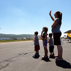 Tara Hardinger and her children Kenner, Trinelle and Taggart watch as a plane takes off during the Skypark Aviation Festival and Expo at Skypark Airport in Woods Cross on Friday, June 2, 2017. The expo is Utah's largest annual aviation event.