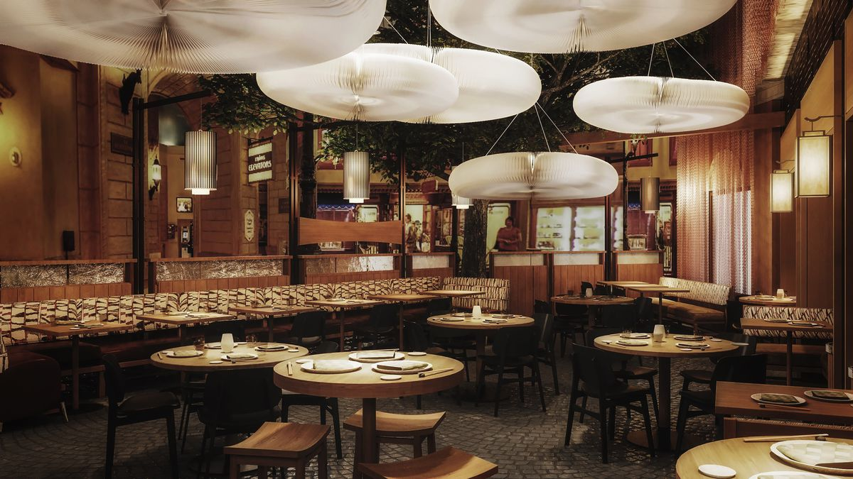 A restaurant with white lights that are large ovals overhead.