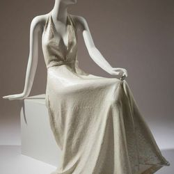 """""""In stark contrast to a lot of [Yves Saint Laurent's] pieces we have Halston, who's clearly enamored with 1930's fashions. There are these body-hugging, diaphanous dresses that are making visible the lines of the wearer's body, even if they're not tightly"""