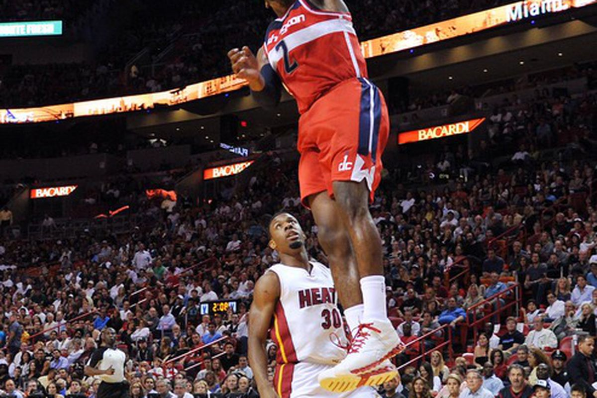 April 21, 2012; Miami, FL, USA; Washington Wizards point guard John Wall (2) dunks over Miami Heat point guard Norris Cole (30) during the first half at American Airlines Arena. Mandatory Credit: Steve Mitchell-US PRESSWIRE