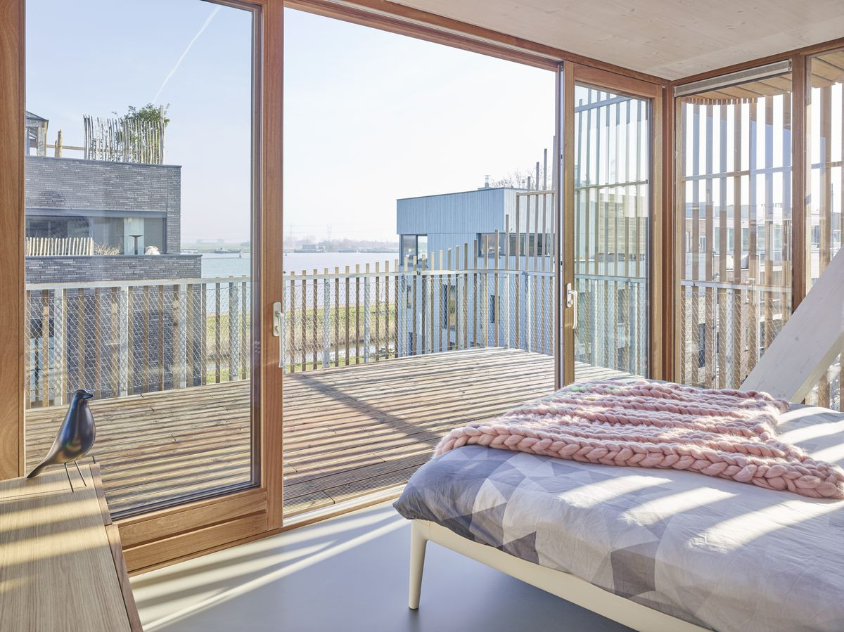 Bedroom with large timber terrace.