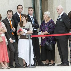 Attendees line up outside the Ogden temple Sunday as hundreds gather for the rededication.