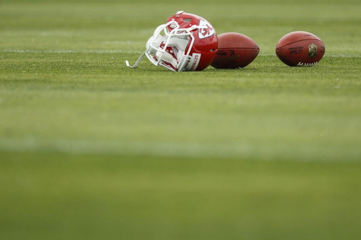 KANSAS CITY, MO - May 13: The helmet of Matt Szymanski #14 of the Kansas City Chiefs lays on the field during the Kansas City Chiefs Minicamp on May 13, 2012 at the Chiefs Training Facility in Kansas City, Missouri. (Photo by Kyle Rivas/Getty Images)