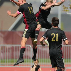 Maple Mountain's Seth Krommenhoek (11) celebrates a goal against Wasatch with Brian Bess (2) in Spanish Fork on Thursday, April 29, 2021.