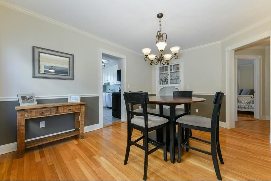 A dining room with built-in cabinets and a table with four chairs.