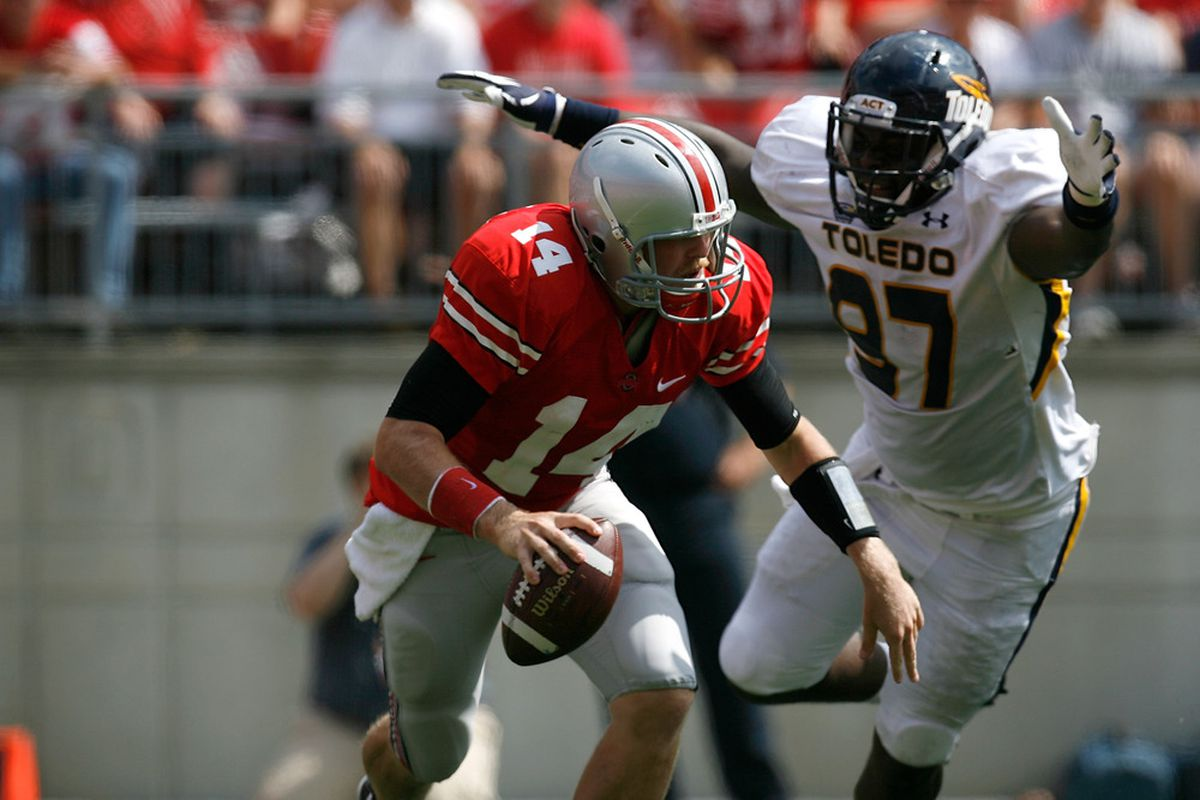 COLUMBUS, OH - SEPTEMBER 10:  Joe Bauserman #14 of the Ohio State Buckeyes is chased by Malcolm Riley #92 of the Toledo Rockets during the second quarter on September 10, 2011 at Ohio Stadium in Columbus, Ohio. (Photo by Kirk Irwin/Getty Images)