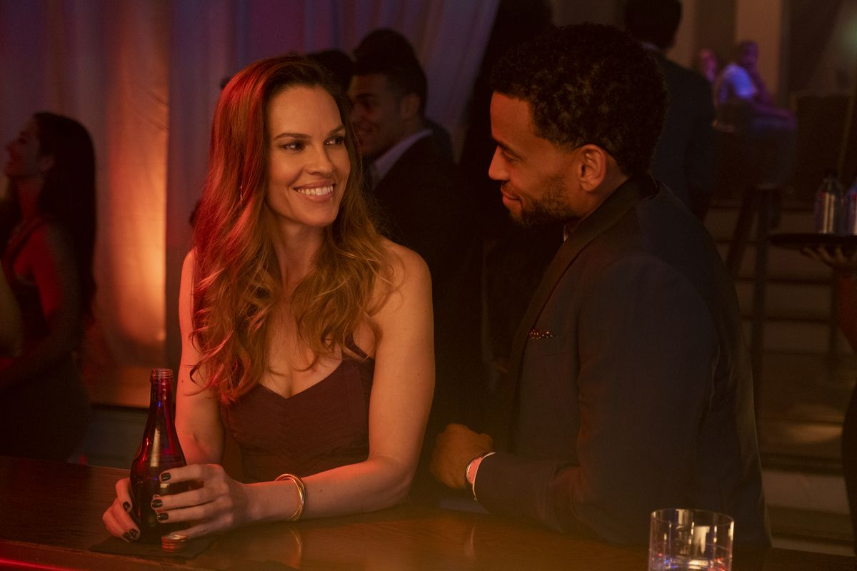 Fatale: Hilary Swank smilse at Michael Ealy at a bar