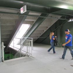 """6:25 p.m. One of the bleacher aisle """"tunnels"""" in right field. The access stairs are on the left. The future elevator is on the right. This is under the right-field porch -"""