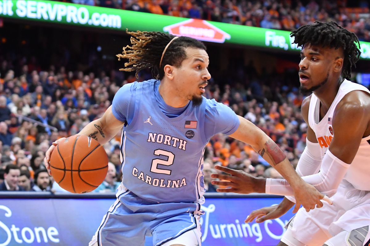 North Carolina Tar Heels guard Cole Anthony works to get the ball past Syracuse Orange forward Quincy Guerrier in the second half at the Carrier Dome.