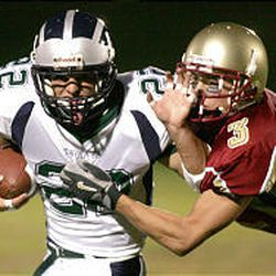Bruin receiver Andrew Bateman, seen at right playing defense, has been MVHS quarterback Don Lovelace's favorite target in 2004.