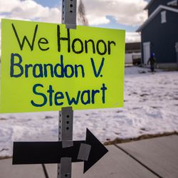 Friends, family, and neighbors put up signs and gather to watch Brandon Stewart go for a ride in BYU football's equipment semi in Clinton on Saturday, Jan. 30, 2021. The ride was his final wish as he battles cancer.