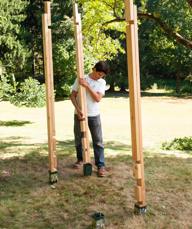 Man Installs Legs Of Arbor Bench