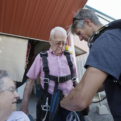 Mary Ashcroft, left, watches as Scotty Freeland adjusts Wendell Ashcroft's harness at Skydive Ogden in Ogden on Saturday, Aug. 5, 2017.