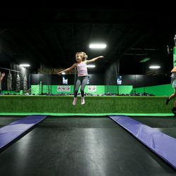 Julia Rossiter, Allison King and Emory King, left to right, play on trampolines at Get Air Salt Lake in Murray on Friday, July 29, 2016.