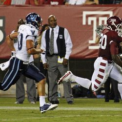 Villanova's Joe Sarnese, left, defends as Temple's Kenneth Harper runs for a touchdown during the second half of an NCAA college football game on Friday, Aug. 31, 2012, in Philadelphia. Temple won 41-10.