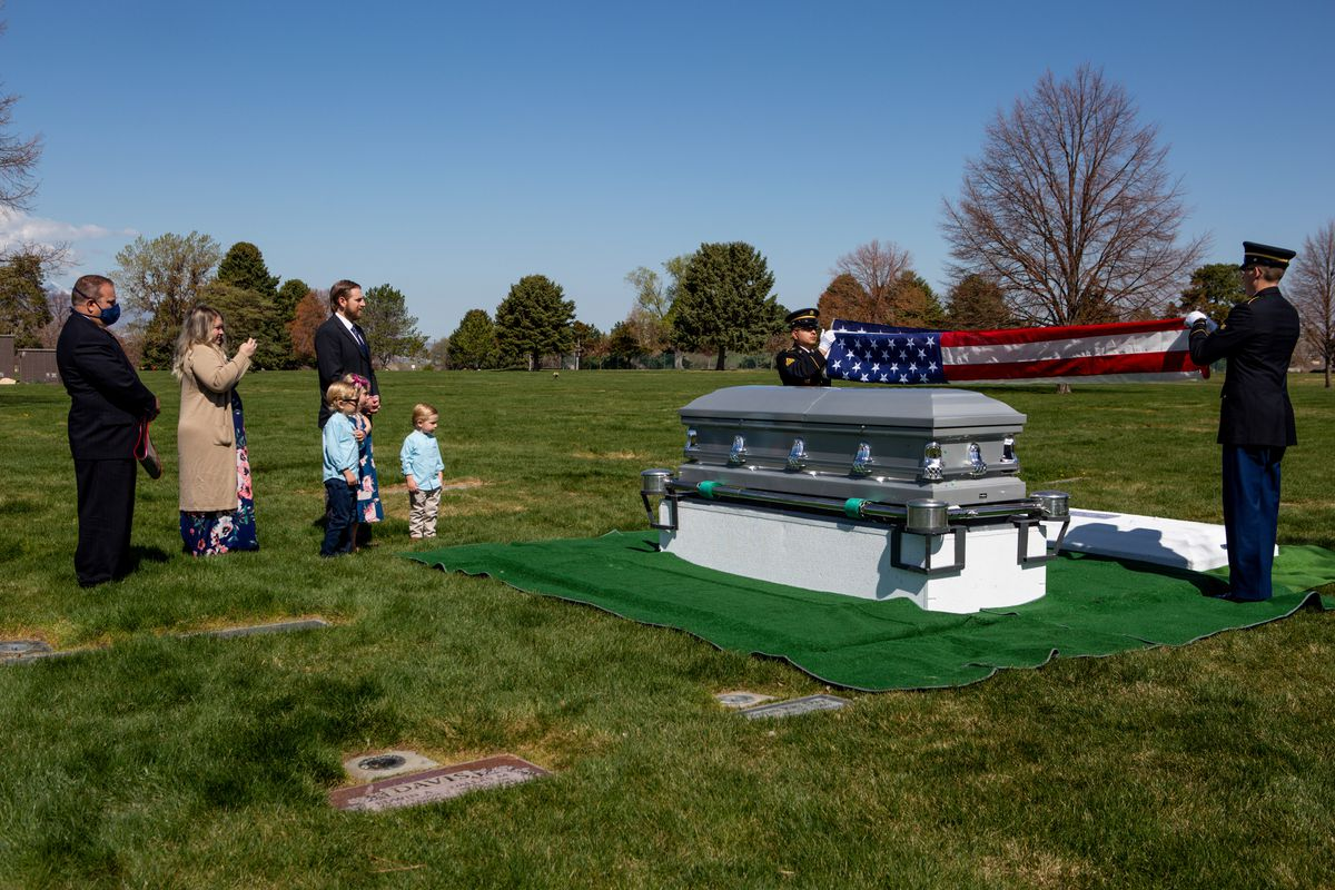Accompanied by funeral director Tom Ligman, left, Clarissa Ragar, Joel Ragar, and their children Decklin Ragar, 5, Evalee Ragar, 7, and Wynston Ragar, 3, attend their grandfather Richard Ragar's funeral service at Larkin Sunset Gardens in Sandy on Monday, April 20, 2020. The World War II veteran lived in Alpine with his wife before moving to Arizona and passing away after being hospitalized alone for about a month at age 9e during the coronavirus pandemic.