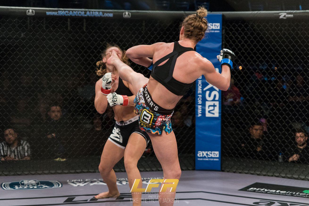 Hailey Cowan (blue gloves) lands a KO kick on Jessica Sotack at LFA 55