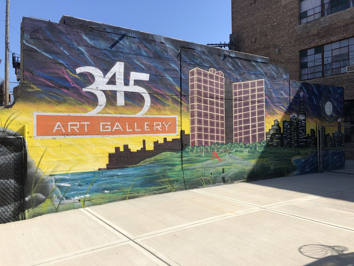 A mural outside the 345 Art Gallery on the West Side shows the Chicago lakefront and skyline.