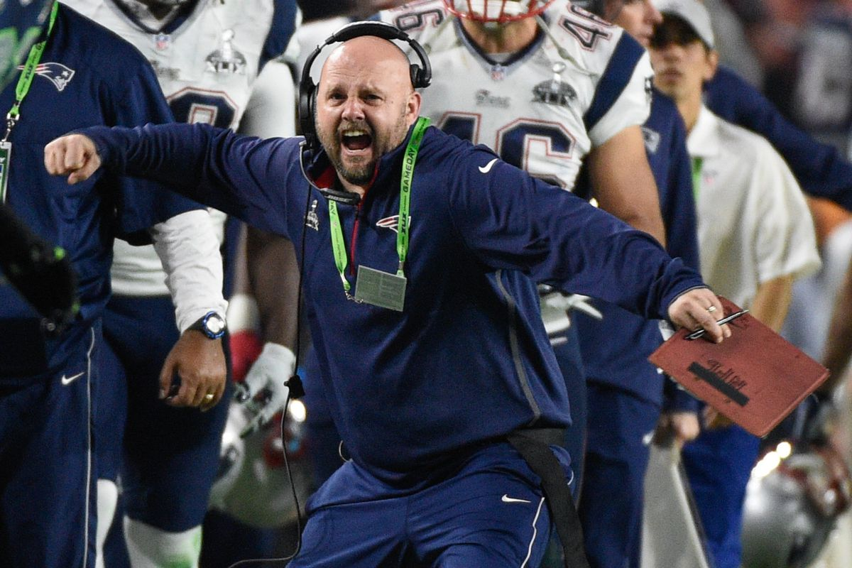 No pictures of Asante Cleveland in a Patriots uniform. Here's a picture of his position coach instead.