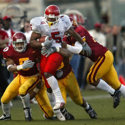 Adam Tate runs for a critical first down in the fourth quarter as Utah beat USC 10-6 in the Las Vegas Bowl on Dec. 25, 2001. The teams have split a pair of bowl games.