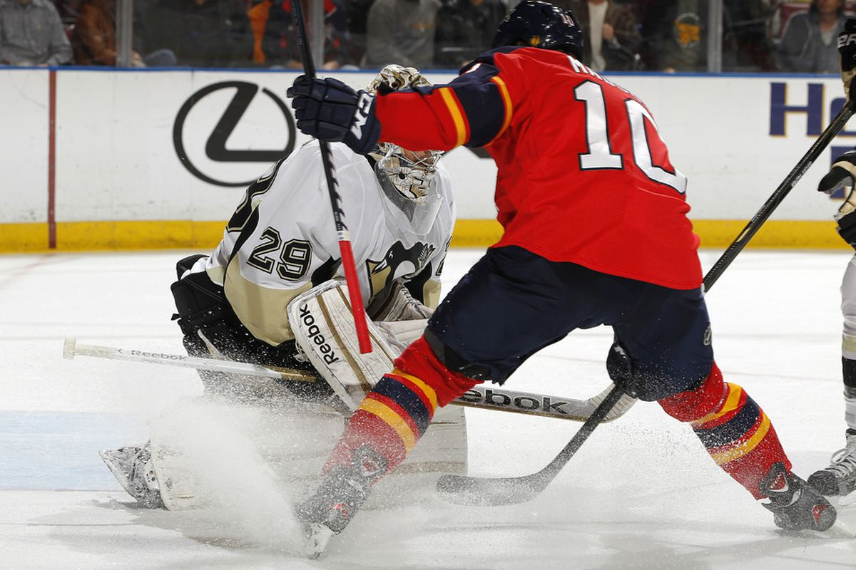 SUNRISE, FL - JANUARY 13: Goaltender Marc-Andre Fleury #29 of the Pittsburgh Penguins stops a shot by John Madden #10 of the Florida Panthers on January 13, 2012 at the BankAtlantic Center in Sunrise, Florida.  (Photo by Joel Auerbach/Getty Images)