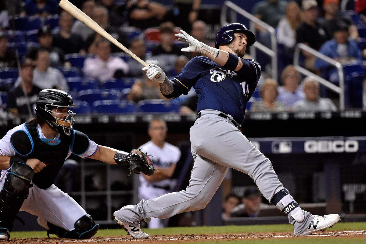 Milwaukee Brewers catcher Yasmani Grandal connects for an RBI double against the Miami Marlins in the third inning at Marlins Park.