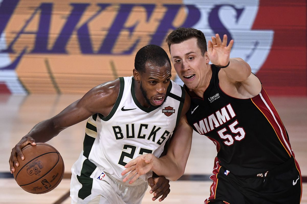 Khris Middleton of the Milwaukee Bucks drives the ball against Duncan Robinson of the Miami Heat during the fourth quarter in Game Four of the Eastern Conference Second Round during the 2020 NBA Playoffs at AdventHealth Arena at the ESPN Wide World Of Sports Complex on September 06, 2020 in Lake Buena Vista, Florida.