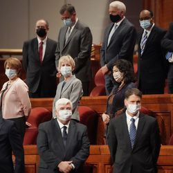 Leaders stand at the end of the Sunday morning session of the 191st Semiannual General Conference of The Church of Jesus Christ of Latter-day Saints in the Conference Center in Salt Lake City on Sunday, Oct. 3, 2021.