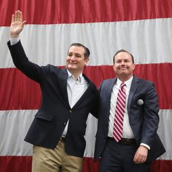 GOP presidential candidate and Texas Sen. Ted Cruz, left, and Sen. Mike Lee, R-Utah, acknowledge the crowd at a rally in Draper at the American Preparatory Academy Saturday, March 19, 2016.