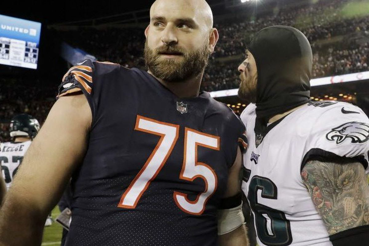 7d3a3faa456 Philadelphia Eagles defensive end Chris Long (56) and his brother, Chicago  Bears offensive guard Kyle Long (75), greet each other after the Bears'  wild-card ...