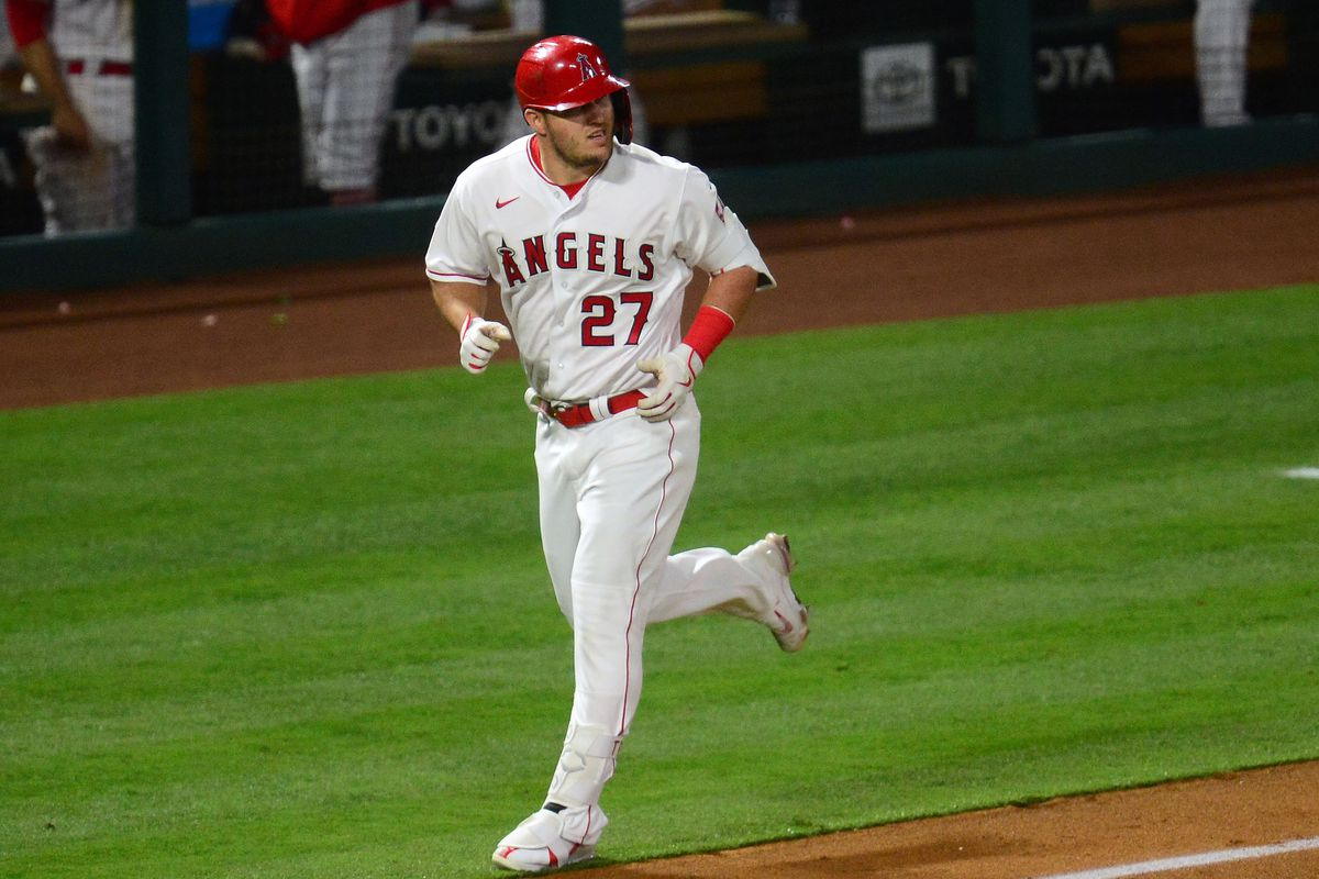 Los Angeles Angels center fielder Mike Trout rounds the bases after hitting a solo home run against the Tampa Bay Rays during the sixth inning at Angel Stadium.