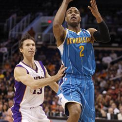 New Orleans Hornets guard Jarrett, Jack, right, attempts a shot past Phoenix Suns guard Steve Nash, left, in the first quarter of an NBA basketball game Sunday, April 1, 2012, in Phoenix.
