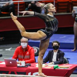 Utah's Maile O'Keefe performs on the bars as Utah and UCLA compete in a gymnastics meet at the Huntsman Center in Salt Lake City on Friday, Feb. 19, 2021.