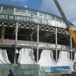 11:58 a.m. A beam being lifted in front of the ballpark -