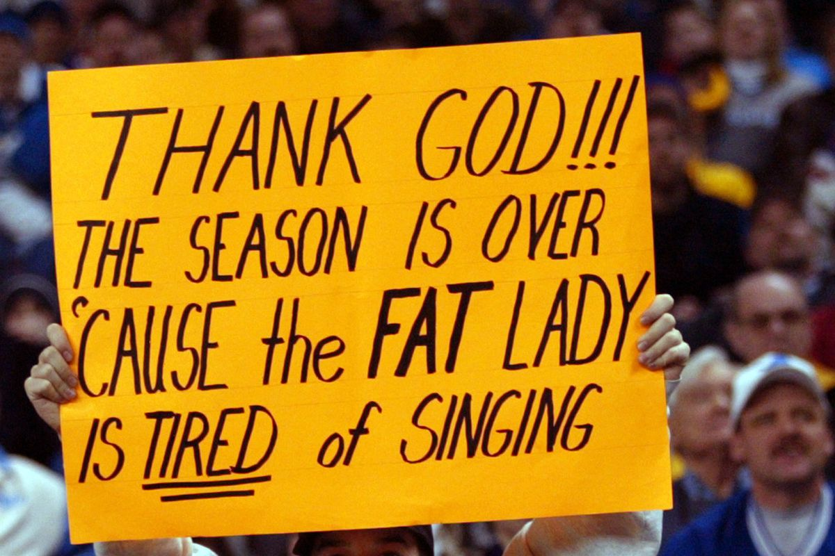 Detroit, MI - Vikings vs Detroit Lions at Ford Field in the final game of the season for both teams. A detroit fan holds a sign that express the feelings of the fans of a team that has only won three games. many Vikings fans may feel the same way after