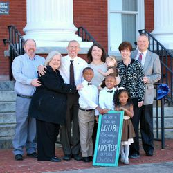 Richard Oden was in foster care as a child until Gerry and Debbie Oden adopted him around age 13. This year, Oden and his wife Brittany, shown with her parents, Joan and Greg Parker, adopted their three foster kids. Elijah, Kentrell and Gabbi are shown with their little sister, Annabelle.