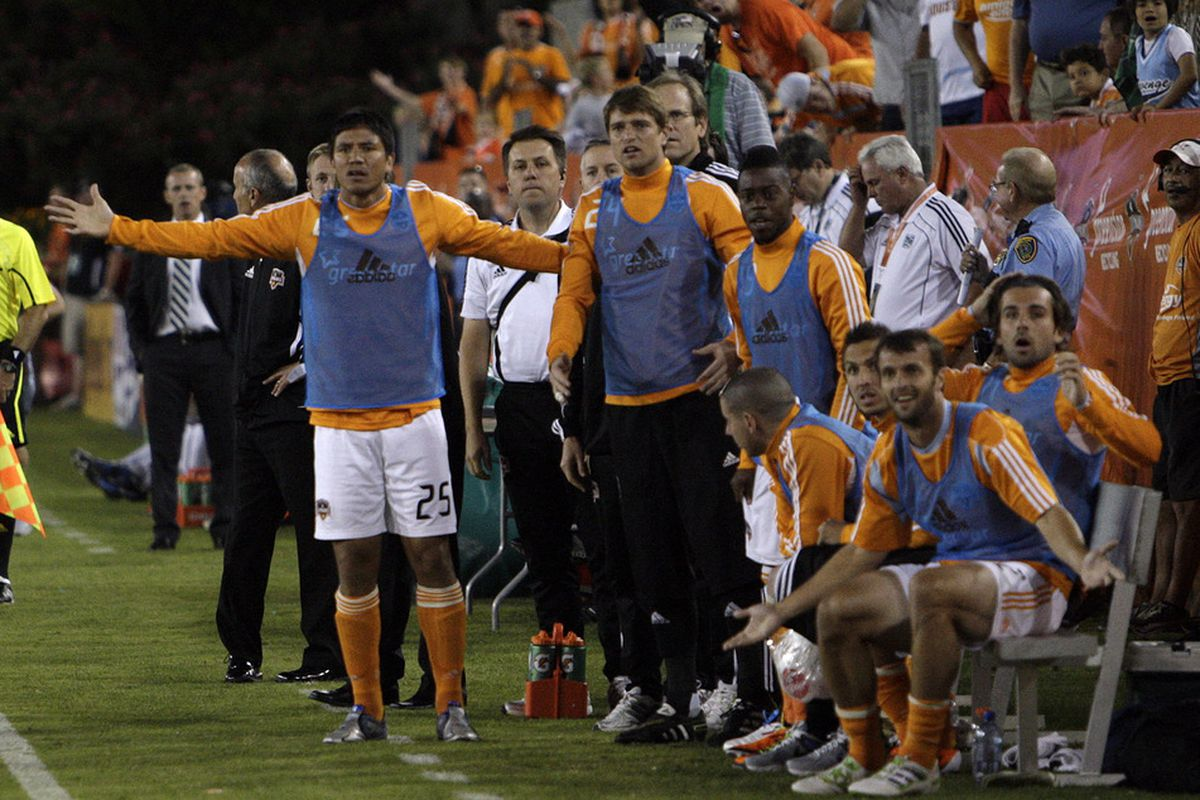HOUSTON - MAY 04:  Brian Ching #25 of the Houston Dynamo and the bench erupt after a penalty call by referee Terry Vaughn at Robertson Stadium on May 4, 2011 in Houston, Texas.  (Photo by Bob Levey/Getty Images)