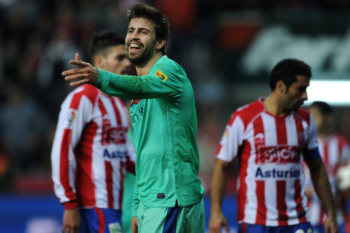 GIJON SPAIN - FEBRUARY 12:  Gerard Pique of Barcelona reacts during the la Liga match between Sporting Gijon and Barcelona at El Molinon Stadium on February 12 2011 in Gijon Spain.  (Photo by Jasper Juinen/Getty Images)