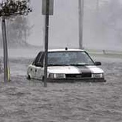 Floodwaters surround a car in downtown New Orleans early Monday as high winds and rain batter the Louisiana coast as Hurricane Katrina makes landfall.