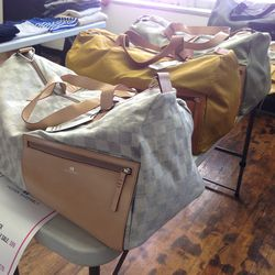 Proper Assembly duffle bags, $75