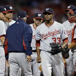 Washington Nationals starting pitcher Edwin Jackson (33) walks off the field after being pulled out of the baseball game during the second inning against the St. Louis Cardinals on Friday, Sept. 28, 2012, in St. Louis.