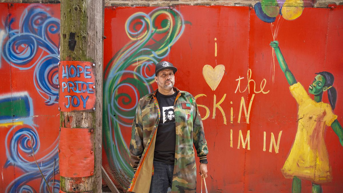 Paul Branton in front of his mural under the CTA Green Line tracks in the 300 block of East 47th Street in Bronzeville.