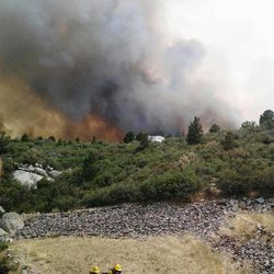 Firefighters work near a wildfire burning along a ridge in Yarnell, Ariz., in this photo provided by the U.S. Forest Service, Monday, July 1, 2013.  The  lightning-sparked fire, which started last Friday, spread to at least 2,000 acres amid triple-digit temperatures, overtook an elite group of firefighters, killing 19 members as they tried to protect themselves from the flames under fire-resistant shields. (AP Photo/U.S. Forest Service)