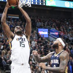 Utah Jazz forward Derrick Favors (15) goes up for a dunk as Utah hosts New Orleans at Vivint Arena in Salt Lake on Friday, Dec. 1, 2017.