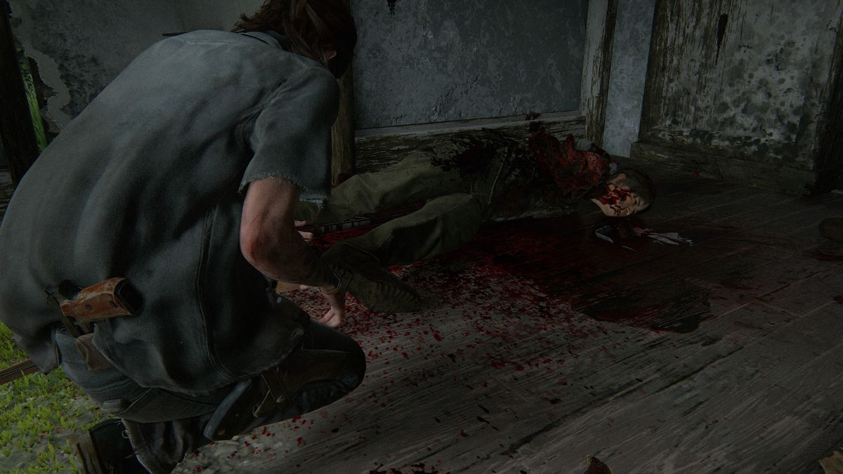 Ellie kneels over a dead body in The Last of Us Part 2