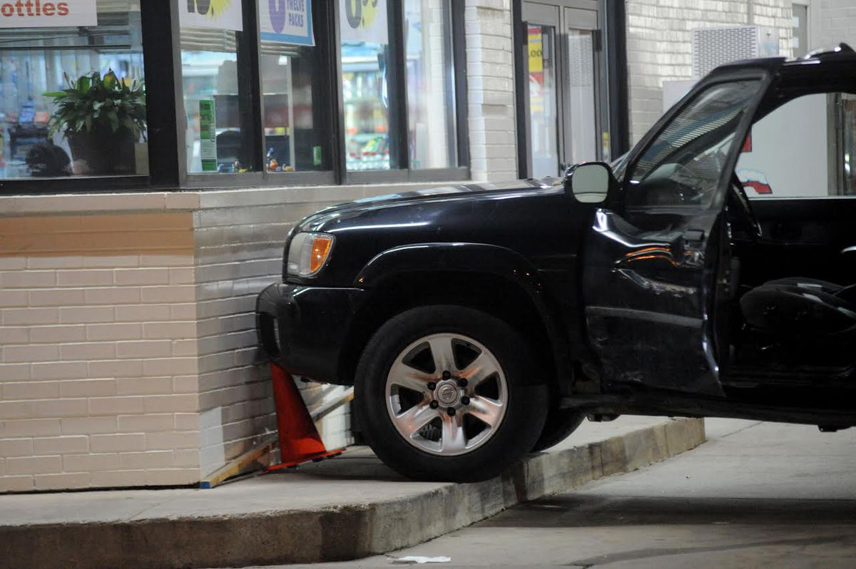 An SUV crashed into a gas station Tuesday morning in south suburban Posen.   Justin Jackson/Sun-Times